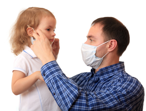 dad puts mask on daughter