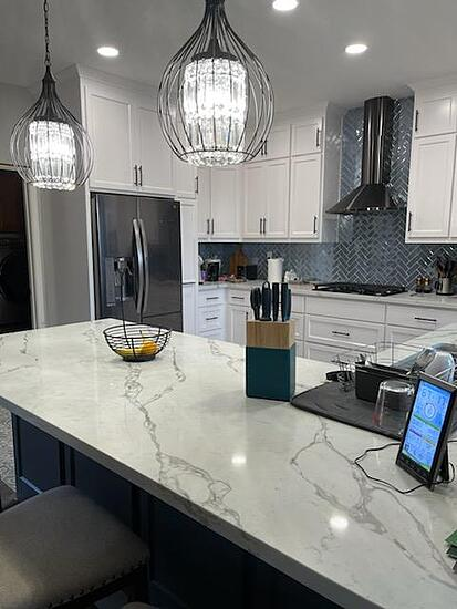 Finished Kitchen with white cabinets and countertops