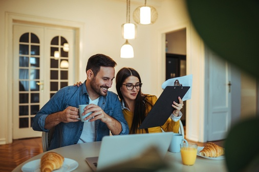 couple looking at to do list
