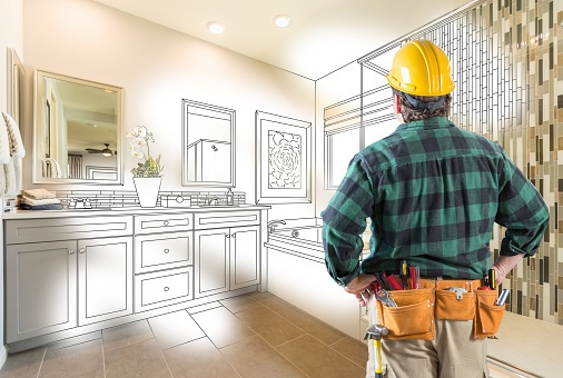contractor looking at bathroom remodel plans