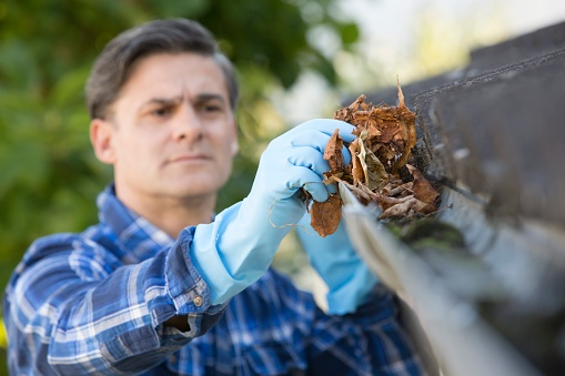 man_cleaning_gutters