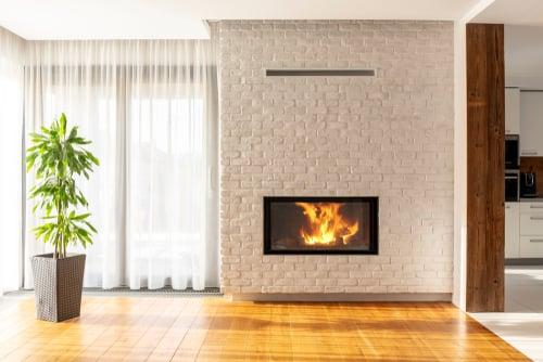 brick fireplace painted white