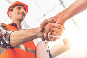 contractor shaking hands with client