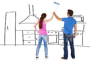 couple painting kitchen during renovation