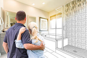 couple planning bathroom remodel