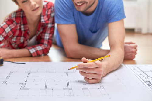 couple working on home remodeling plans