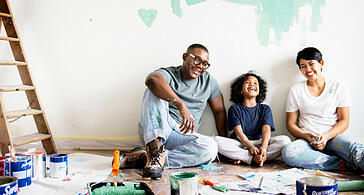 family renovating home and smiling