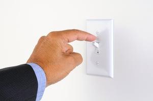 hand flicking light switch