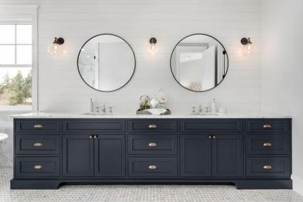 luxurious bathroom vanity with black cabinets
