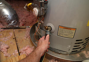 person performing water heater maintenance
